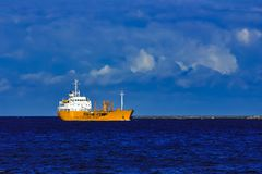 Yellow tanker ship. Yellow cargo tanker ship moving at the clear summer day Stock Photography