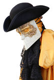 Yellow carnival costume of an ancient noble Venetian. Venice Italy, yellow carnival costume of a noble Venetian with black hat Royalty Free Stock Photo