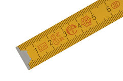 Yellow carpenter's rule. With centimeters numbers with centimeters numbers, isolated over white Royalty Free Stock Images