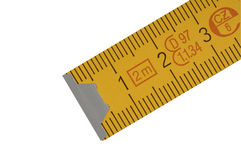 Yellow carpenter's rule. With centimeters numbers with centimeters numbers, isolated over white Stock Photo