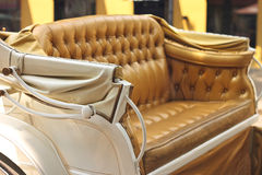 Yellow carriage sofa on  city street Royalty Free Stock Image
