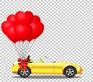 Yellow cartoon cabriolet car with bunch of red balloons. Yellow modern opened cartoon cabriolet car with bunch of red helium heart shaped balloons with festive Royalty Free Stock Photo