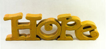 Yellow Carved Wooden Hope Sign Stock Photography