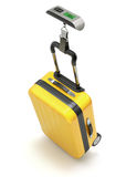 Yellow case on digital electronic luggage weight scale Stock Image