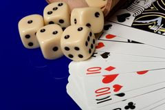 Yellow casino dice with cards Royalty Free Stock Image