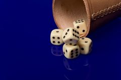Yellow casino dice with cup Royalty Free Stock Images