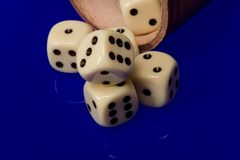Yellow casino dice with cup Stock Photo