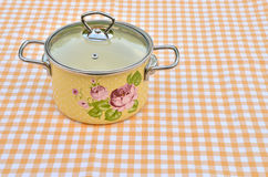 Yellow casserole with floral pattern Stock Photos