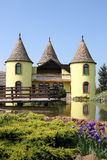Yellow castle with pond Eastern Europe Stock Photos