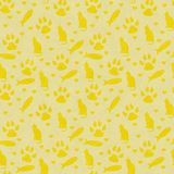 Yellow cat, paw prints, fish, and hearts seamless and repeat pattern background. With texture royalty free illustration