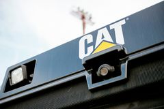 Yellow Cat tractor bulldozer with rear-view security camera Stock Photo