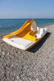 Yellow catamaran on a beach Stock Photo
