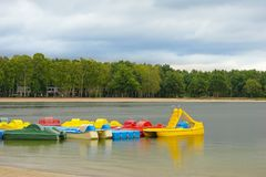 Yellow catamaran on the beach. Preparation for the beach season. Entertainment at sea. stock image
