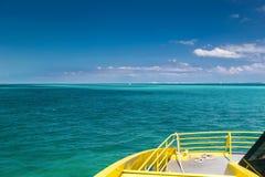 Yellow catamaran in caribbean sea Stock Images