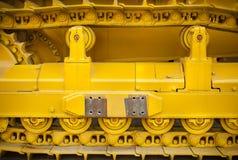 Yellow caterpillar track Stock Image