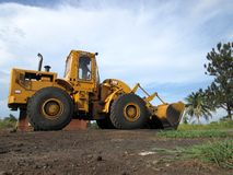 Yellow Caterpillar tractor 966G. Yellow Caterpillar tractor used in the different tasks of the construction industry , such as earthwork, materials , debris Stock Photo