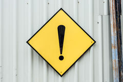 A yellow caution exclamation mark metal sign stock photo