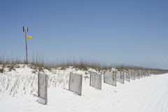 Yellow Caution Flag. A yellow caution flag warns swimmers at a beach near Pensacola, Florida stock images