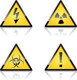 Yellow Caution Labels. Yellow High Voltage, Radiation, Biohazard and Exclamation Triangle Sign Labels Stock Images