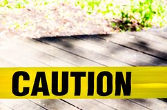 Yellow Caution sign, hazard tape to improve worksite safety. A Yellow Caution sign, hazard tape to improve worksite safety stock image