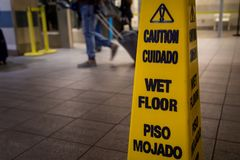 Yellow caution slippery wet floor sign . stock image