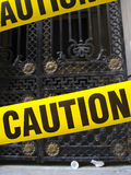 Yellow caution tape. On a metal barrier Stock Photos