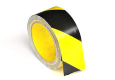 Yellow caution tape. On white background stock photo