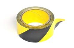 Yellow caution tape. On white background Royalty Free Stock Photo