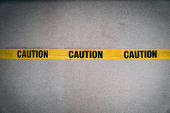 Yellow CAUTION tape barring entrance with added grain. And grooming tone Stock Photo