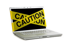Yellow caution tape on a computer screen Stock Image
