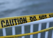 Yellow caution tape royalty free stock photos