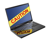Yellow caution tape over laptop screen. Stock Photos