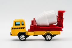 Yellow cement mixer truck toy isolated on white. Background. Building and construction industry, industrial business commercial concept stock images