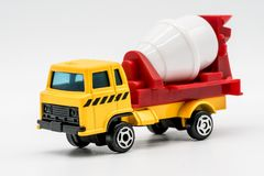 Yellow cement mixer truck toy isolated on white. Background. Building and construction industry, industrial business commercial concept royalty free stock photo