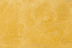 Yellow Cement texture for pattern and background Stock Photos