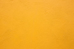 Yellow cement wall Royalty Free Stock Images