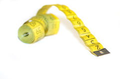 Yellow centimeter. A yellow centimeter measure on white background Royalty Free Stock Photography