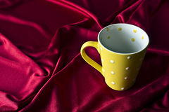 Yellow ceramic cup Stock Image