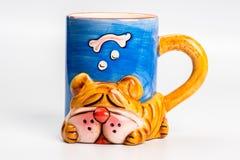 Yellow ceramic mug with dog  on white Royalty Free Stock Photography