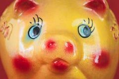 Yellow ceramic piggy bank Stock Images