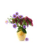 Yellow ceramic vase with bouquet. Autumn blue and claret colors on white background Royalty Free Stock Photography