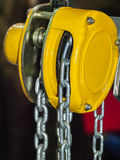 Yellow chain hoist. Chain hoist for lifting with a blurred background Stock Images