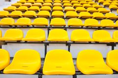 Yellow chair. Seat grandstand yellow watch the games inside the stadium Stock Photos