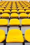 Yellow chair. Seat grandstand yellow watch the games inside the stadium Stock Image