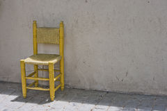Yellow Chair against Brick Wall in Istanbul Stock Photos