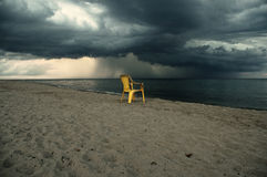Yellow chair on the beach Stock Image