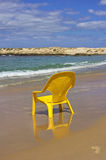 Yellow chair on the beach Royalty Free Stock Photo