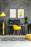 Hipster workspace with yellow equipment. Yellow chair at desk with desktop computer and plant in striped pot in hipster workspace with yellow equipment Royalty Free Stock Photography