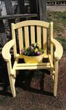 Yellow chair with flowers royalty free stock image