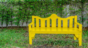 Yellow chair in garden Stock Photo